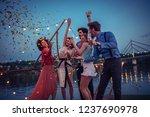 young friends enjoying a night...   Shutterstock . vector #1237690978