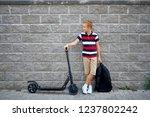 school boy in standing with his ...   Shutterstock . vector #1237802242