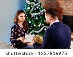couple sharing christmas... | Shutterstock . vector #1237816975