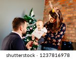 first baby christmas. happy... | Shutterstock . vector #1237816978