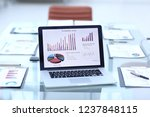 financial data on the laptop... | Shutterstock . vector #1237848115