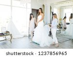 satisfied hispanic bride... | Shutterstock . vector #1237856965