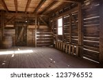 Interior of old barn - stock photo