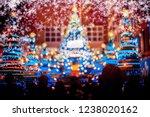 people in christmas lighting...   Shutterstock . vector #1238020162