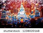 people in christmas lighting...   Shutterstock . vector #1238020168