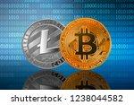 Bitcoin (BTC) and Litecoin (LTC) coins on the binary code background; bitcoin vs litecoin