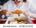 attractive asian woman eating... | Shutterstock . vector #1238111422