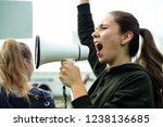 female activist shouting on a...   Shutterstock . vector #1238136685