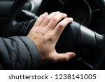 hand on the steering wheel ...   Shutterstock . vector #1238141005