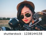 young woman on a motorcycle in... | Shutterstock . vector #1238144158