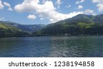 mountains reflecting in water.... | Shutterstock . vector #1238194858