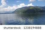 mountains reflecting in water.... | Shutterstock . vector #1238194888