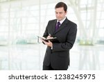 pensive businessman with a book ... | Shutterstock . vector #1238245975