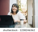 happy asian woman working with... | Shutterstock . vector #1238246362