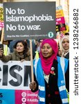 London, United Kingdom, November 17th 2018:- Stop the war activist at the Stand Up To Racism march through central London from the BBC to near Downing Street in Whitehall - stock photo