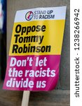 London, United Kingdom, November 17th 2018:- A sign against Tommy Robinson at the Stand Up To Racism march through central London from the BBC to near Downing Street in Whitehall - stock photo