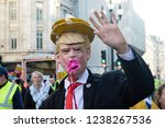 London, United Kingdom, November 17th 2018:- A protester dressed as Donald Trump at the Stand Up To Racism march through central London from the BBC to near Downing Street in Whitehall - stock photo