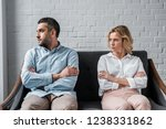 angry couple sitting on couch... | Shutterstock . vector #1238331862