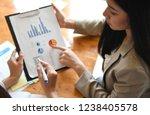 female office worker holding... | Shutterstock . vector #1238405578