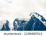 snowy mountain top in overcast... | Shutterstock . vector #1238483512