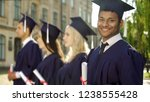mixed race graduate student... | Shutterstock . vector #1238555428