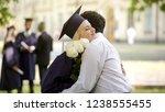 boyfriend giving flowers to his ... | Shutterstock . vector #1238555455