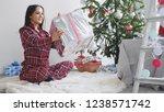 happy brunette girl holds gift...   Shutterstock . vector #1238571742