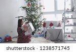 happy brunette girl holds gift...   Shutterstock . vector #1238571745