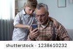 grandson explaining grandpa how ... | Shutterstock . vector #1238610232