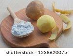 potato starch in a wooden spoon....   Shutterstock . vector #1238620075