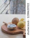 potato starch in a wooden spoon....   Shutterstock . vector #1238620522