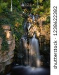waterfall in a park of the city ... | Shutterstock . vector #1238622382