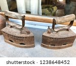 two old style vintage flatirons | Shutterstock . vector #1238648452