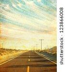 An Empty Desert Road In Arizon...