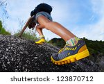 hiker with backpack climbing... | Shutterstock . vector #123870712