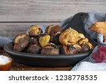 roasted chestnuts with salt in... | Shutterstock . vector #1238778535