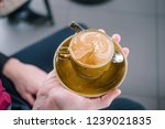 a cup of coffee in the hand of... | Shutterstock . vector #1239021835
