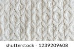 knitted white woolen background | Shutterstock . vector #1239209608