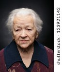 Portrait Of Old Woman On A Gra...