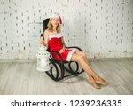 attractive snow maiden  in a... | Shutterstock . vector #1239236335