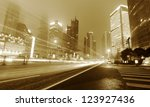 moving car with blur light... | Shutterstock . vector #123927436