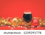 snifter glass of dark ale or... | Shutterstock . vector #1239291778