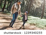 a little curly girl in hat is... | Shutterstock . vector #1239340255