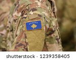 Kosovo flag on soldiers arm (collage).