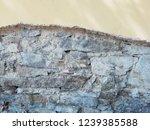 old cracked plaster. textured...   Shutterstock . vector #1239385588