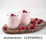yogurt with cranberry. two... | Shutterstock . vector #1239389812