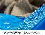 water drops on waterproof blue... | Shutterstock . vector #1239399382