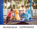 happy funny two little children ... | Shutterstock . vector #1239434032