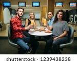 friends drinks and eats pizza... | Shutterstock . vector #1239438238