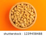 roasted peanuts in wooden bowl... | Shutterstock . vector #1239458488